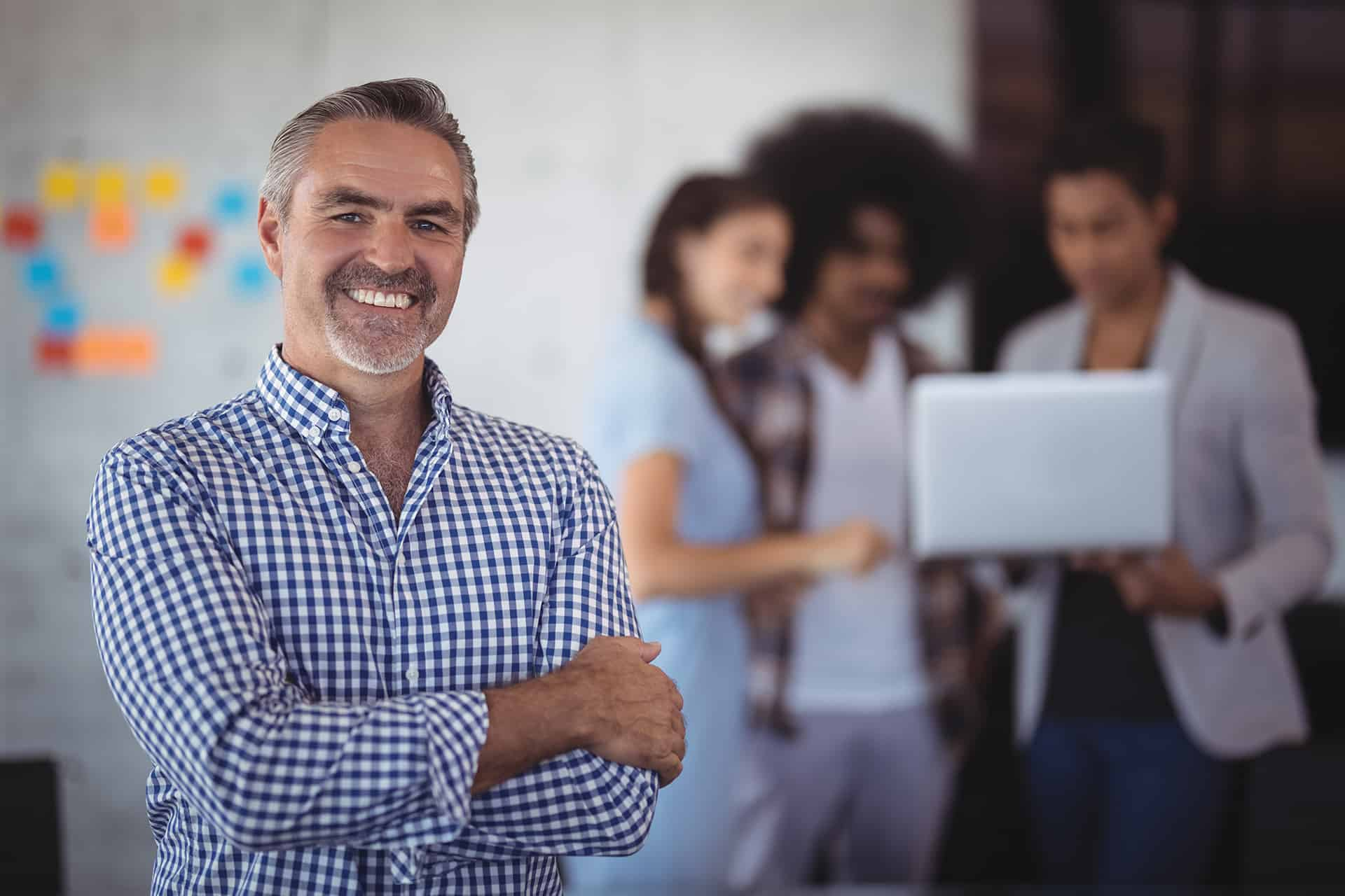 benefits of case studies portrait of smiling businessman with team feature image