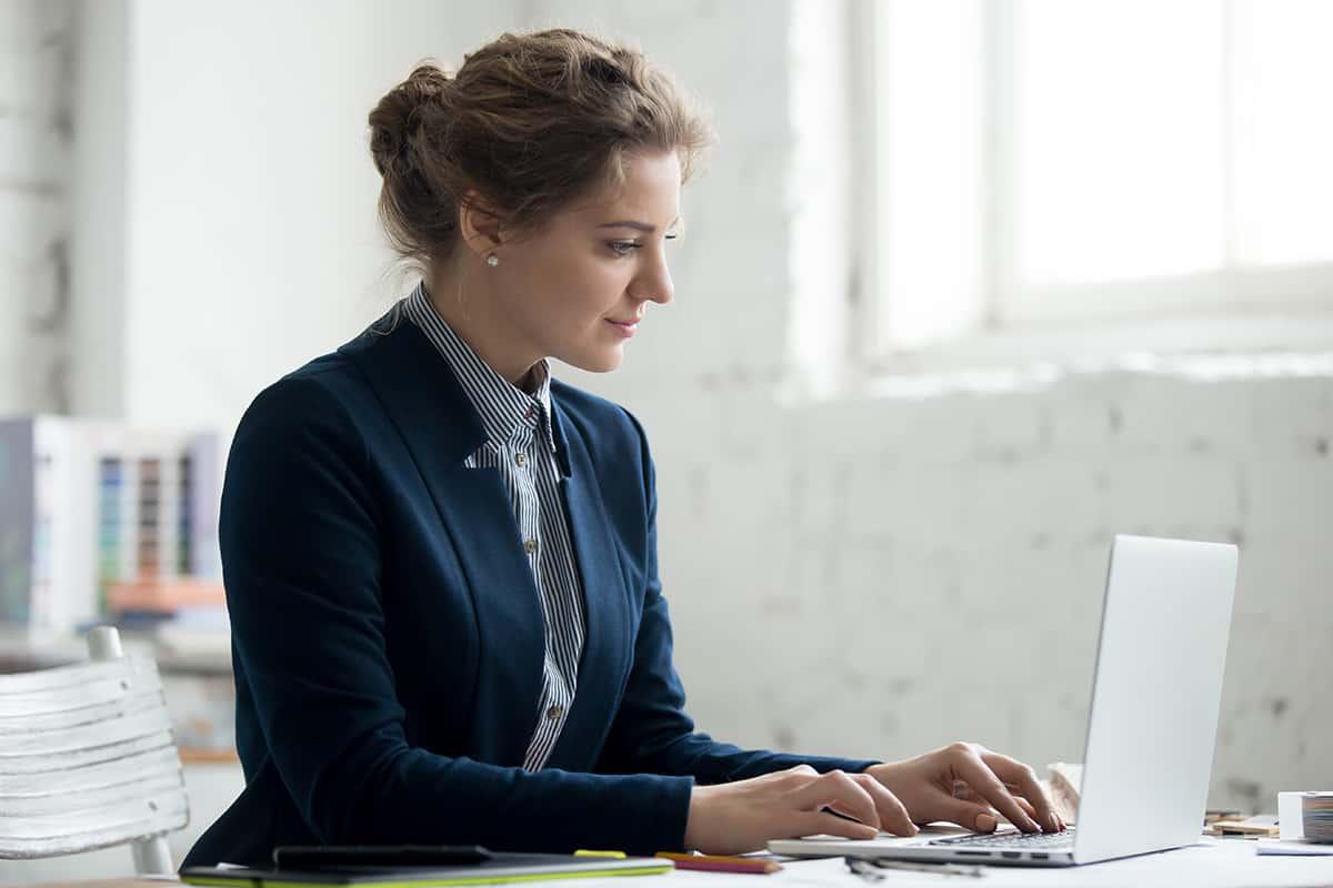 female office worker on laptop