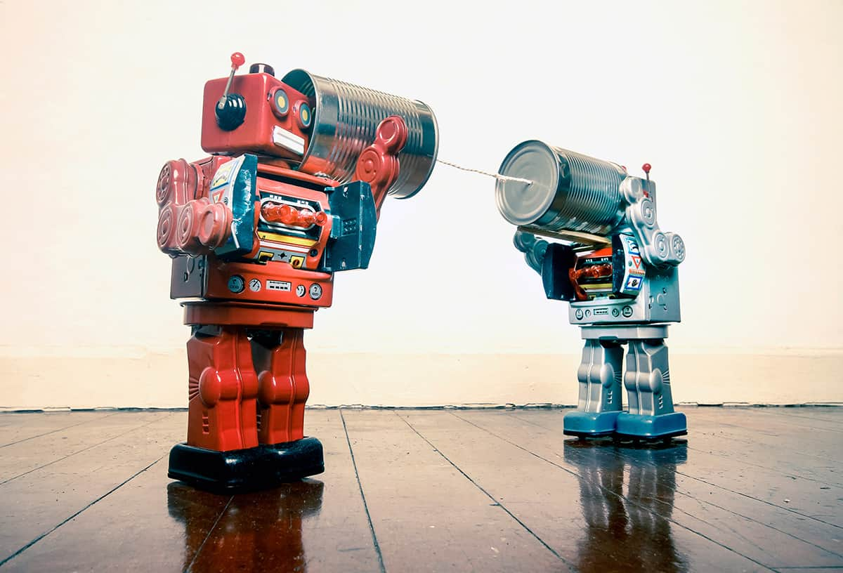 how to enhance customer service and experience two retro robots talking on tin phones