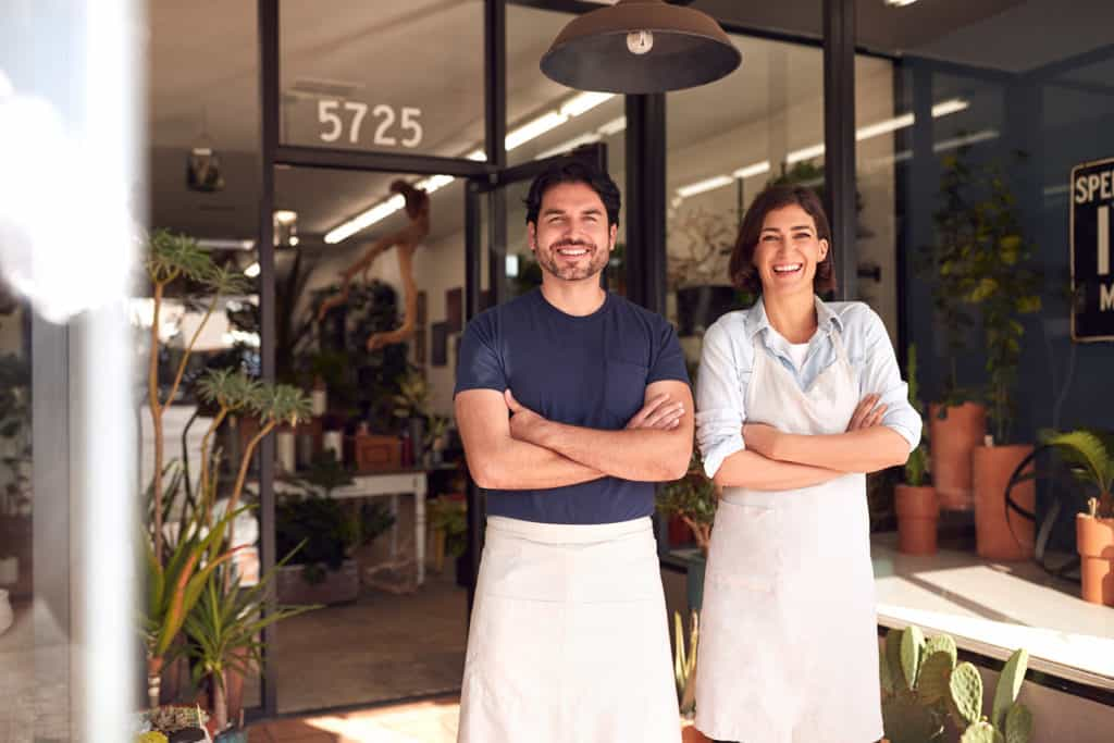 plant shop portrait of smiling owners outside featured image
